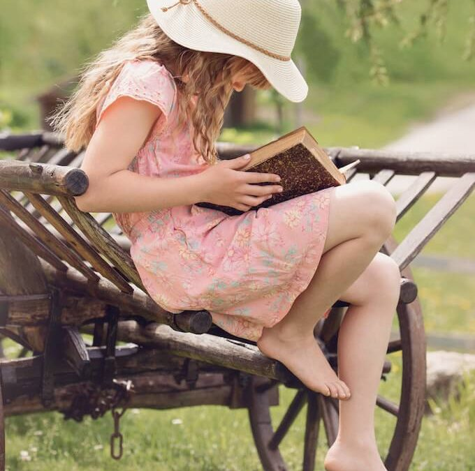 Photo of a girl reading a book filled with myths and legends.