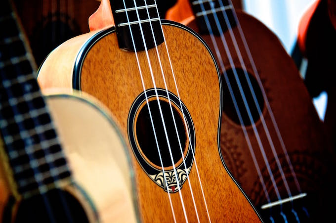 A close up shot of three guitars in a row
