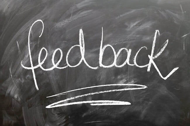 """A chalkboard featuring the word """"feedback,"""" illustrating the post How to Shop for Book Editing Services"""